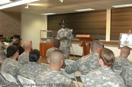Lt. Col. Barry Dickerson, the 1st Cavalry Division's Equal Opportunity Program manager, tells Soldiers gathered in the division's headquarters on Fort Hood, Texas, how Black History Month was created during an observance Feb.21. Retired Command Sgt. Maj. A.C. Cotton, the guest speaker and the only African American to serve as the First Team's command sergeant major thus far, also talked about his career to the Soldiers in the audience asking them to embrace their jobs as leaders.  Photo Credit: Feb 22, 2008
