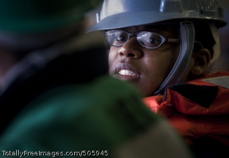 101221-N-2055M-211 PACIFIC OCEAN (Dec. 21, 2010) Boatswain's Mate Seaman Charlesa Anderson discusses signals to give to the Military Sealift Command fleet replenishment oiler USNS Guadalupe (T-AO 200) during a replenishment at sea aboard the aircraft carrier USS Carl Vinson (CVN 70). Carl Vinson and Carrier Air Wing (CVW) 17 are on a deployment to the U.S. 7th and U.S. 5th Fleet areas of responsibility. (U.S. Navy photo by Mass Communication Specialist 3rd Class Travis K. Mendoza/Released)