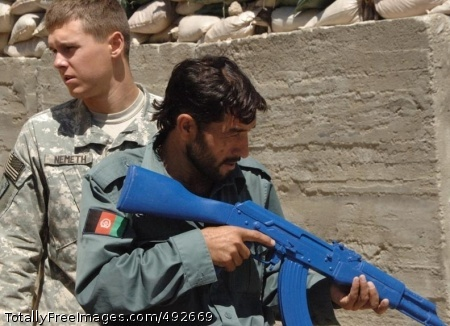 Soldiering in Spc. Jeremiah Nemeth teaches tactics to an Afghan policeman at Forward Operating Base Kalagush. Photo Credit: Jul 5, 2007