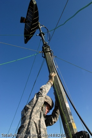 U.S. Army Europe Sgt. Eric Lewis from the 72nd Signal Battalion of U.S. Army Europe's 5th Signal Command raises a line-of-site antenna during the battalion's network exercise 'Dragon Warrior' at the Grafenwoehr (Germany) Training Area.   Photo Credit: Feb 5, 2008