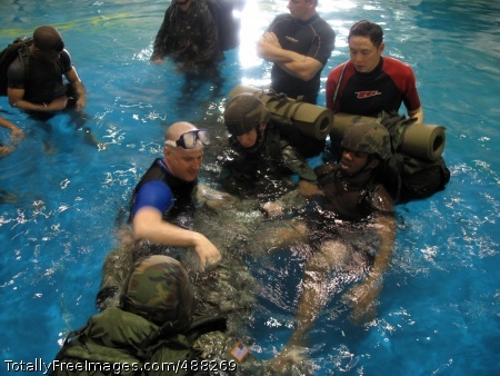Water 1 Jon Pearlman teaches Soldiers how to float as a group with their rucksacks during the vehicle-ditching portion of his water survival course at Camp Humphreys, Korea. Photo Credit: Feb 5, 2008