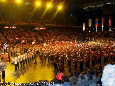 U.S. Army Europe's U.S. Army Europe's 76th Army Band performs in Berlin's Max-Schmeling-Halle alongside some of the 700 of their fellow military musicians from nine countries during the mass band finale of this year's Berlin Military Music Festival.   Photo Credit: Nov 9, 2007
