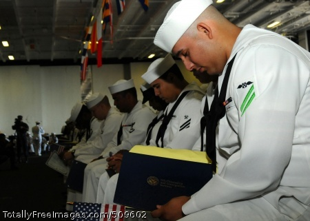 100920-N-7908T-053 NORFOLK (Sept. 20, 2010) A Sailor bows his head during the benediction for a naturalization ceremony aboard the aircraft carrier USS George H.W. Bush (CVN 77). Forty Sailors earned their American citizenship in the first naturalization ceremony ever held aboard George H.W. Bush. (U.S. Navy photo by Mass Communication Specialist 3rd Class Brent Thacker/Released)
