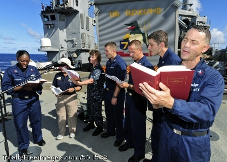 110424-F-HS649-017  PACIFIC OCEAN (April 24, 2011) Choir members sing hymns during an Easter service on the flight deck of the amphibious transport dock ship USS Cleveland (LPD 7) during Pacific Partnership 2011. Pacific Partnership is a five-month humanitarian assistance initiative that has completed a mission in Tonga, and will visit Vanuatu, Papua New Guinea, Timor-Leste and the Federated States of Micronesia. (U.S. Air Force photo by Tech. Sgt. Tony Tolley/Released)