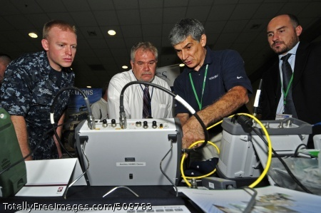100913-N-7364R-034 NAPLES, Italy (Sept. 13, 2010) Electronics Technician 3rd Class Steven MacDonald observes a demonstration from an Anritsu Company representative on telecommunications equipment during the 10th annual Technology Exposition at Ciao Hall.  The event showcased emerging technologies from 29 companies.  (U.S. Navy photo by Mass Communication Specialist 2nd Class Felicito Rustique/Released)