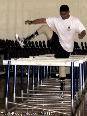 Walter Reed Gunnery Sgt. Angel Barcenas demonstrates an agility drill on the last day of the Military Amputees Advances Skills Training workshop June 1 at Walter Reed Army Medical Center. Photo Credit: Jun 4, 2007