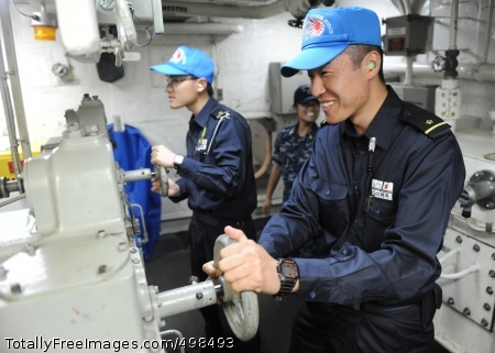 110626-N-PB383-664 PACIFIC OCEAN (June 26, 2011) Ensigns Haruhisa Kosuge, left, and Shohei Yamaguchi, assigned to the Japan Maritime Self-Defense Force, test the back-up steering of the guided-missile frigate USS McClusky (FFG 41) during a joint forces passing exercise. The exercise included six ships from the U.S. and Japan and required the ships to line up in diamond formation and perform various evasive maneuvers, flight operations and mock underway replenishments. (U.S. Navy photo by Mass Communication Specialist 3rd Class Dominique Pineiro/Released)