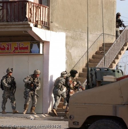 Gen. Casey Says Iraqi security forces and Soldiers from the 319th Airborne Field Artillery Regiment, conduct an early morning search of a suspected IED factory in Tikrit, April 28. Photo Credit: May 15, 2007