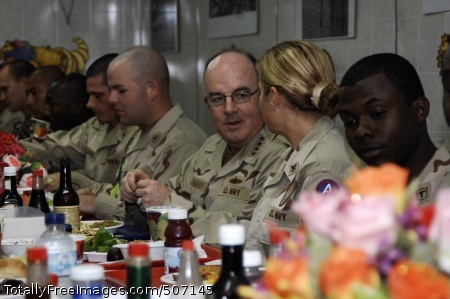 101122-N-9958G-049 CAMP ARIFJAN, Kuwait (Nov. 22, 2010) Adm. John C. Harvey, commander of U.S. Fleet Forces Command, talks with Sailors over dinner in the zone two dining facility at the U.S. Army Camp Arifjan in Kuwait. Harvey is visiting Individual Augmentee and Overseas Contingency Operations Service Assignment Sailors in the U.S. Naval Forces Central Command Forward Kuwait area of responsibility and to observe both the Reception, Staging, Onward movement & Integration program and the Warrior Transition program. (U.S. Navy photo by Chief Mass Communication Specialist Bill Gowdy/Released)