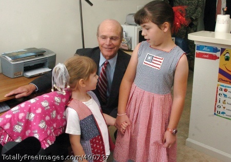 Geren Annika Valliel and her sister, Naomi, talk with Secretary of the Army Pete Geren in their home Wednesday morning. Geren visited Fort Belvoir's George Washington Village.  Photo Credit: Oct 4, 2007
