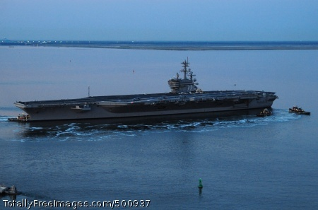 110511-N-VQ827-096 NORFOLK (May 11, 2011) The Nimitz-class aircraft carrier USS George H.W. Bush (CVN 77) departs Naval Station Norfolk for its maiden deployment. George H.W. Bush, the Navy's newest aircraft carrier, deployed as part of the George H.W. Bush Carrier Strike Group supporting maritime security operations and theater security cooperation efforts in the U.S. 5th and 6th Fleet areas of responsibility. (U.S. Navy photo by Mass Communication Specialist 3rd Class Nicholas Hall/Released)