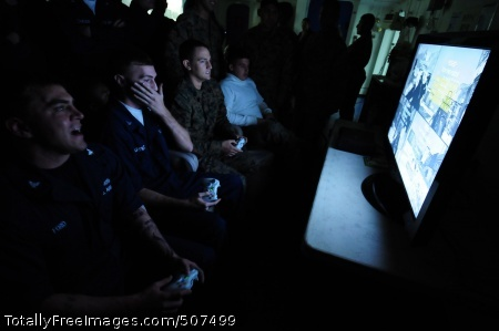 101110-N-3659B-098 PACIFIC OCEAN (Nov. 10, 2010) Sailors and Marines play an opening round match of a video game tournament sponsored by the morale, welfare and recreation committee aboard the amphibious assault ship USS Boxer (LHD 4). Forty-four Sailors and Marines participated in the event. Boxer is underway off the coast of Southern California participating in a composite training unit exercise in preparation for deployment in early 2011. (U.S. Navy photo by Mass Communication Specialist 2nd Class Joseph M. Buliavac/Released)