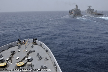 110709-N-GW695-081 GULF OF ADEN (July 9, 2011) The amphibious transport dock ship USS Green Bay (LPD 20), bottom, prepares to come alongside the Military Sealift Command fleet replenishment oiler USNS Leroy Grumman (T-AO 195) and the amphibious dock landing ship USS Comstock (LSD 45) for a replenishment at sea. Green Bay and Comstock, both assigned to the Boxer Amphibious Readiness Group, are underway supporting maritime security operations and theater security cooperation efforts in the U.S. 5th Fleet area of responsibility. (U.S. Navy photo by Mass Communication Specialist 3rd Class Stephen M. Votaw/Released)