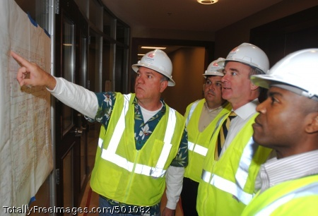 110506-N-1928O-015 NEW ORLEANS (May 6, 2011) Bob Lipscomb, left, of WoodWard Design and Build, project manager for the Marine Force Reserve Headquarters project, identifies locations on a building plan to state Rep. Jeff Arnold, Mark Gorenflo, principal deputy for the Deputy Under Secretary of the Navy for Plans, Policy, Oversight and Integration, and Howard Myrick, a Marine Force Reserve support staff member. The state funded building will be home to more than 1900 active duty, reserve component and full-time support staff. The project has been awarded a Leadership in Energy and Environmental Design (LEED) certification from the U.S. Green Building Council. Gorenflo is touring the facility as part of New Orleans Navy Week, one of 21 Navy Weeks planned across America in 2011. Navy Weeks are designed to show Americans the investment they have made in their Navy and increase awareness in cities that do not have a significant Navy presence. (U.S. Navy photo by Mass Communication Specialist 1st Class Mark O'Donald/Released)