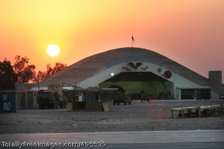 Fly Army! The sun sets over the 36th CAB's hardened aircraft shelter at LSA Anaconda.  Photo Credit: Jan 9, 2007