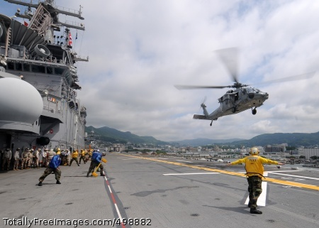 110621-N-SO729-035 SASEBO, Japan (June 21, 2011) An MH-60S Sea Hawk helicopter assigned to the Island Knights of Helicopter Sea Control Squadron (HSC) 25 prepares to land aboard the amphibious assault ship USS Essex (LHD 2) as the ship prepares to get underway. Essex is part of the Essex Amphibious Ready Group. (U.S. Navy photo by Mass Communication Specialist 3rd Class Adam M. Bennett/Released)