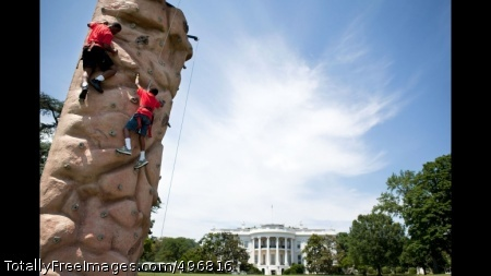 Kids Climb A Rock Wall On The South Lawn Of The White House President Barack Obama talks with Puerto Rican Senator Alejandro Garcia Padilla during a lunch stop at Kasalta, a local restaurant in the Ocean Park neighborhood of San Juan, Puerto Rico, June 14, 2011. (Official White House Photo by Pete Souza)