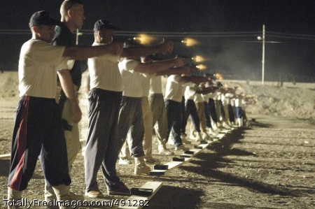 The Thin Blue Line Recruits fire the Glock 9 mm handgun at the Police Training Academy on Camp India in Baghdad. Photo Credit: Sep 25, 2007