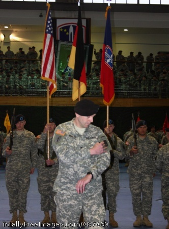 Brigade Changes Col. Jeffrey Sinclair exchanges his 1st Infantry Division 'Big Red One' patch for the shoulder sleeve insignia of the 172nd Infantry Brigade (Separate) as Soldiers change the unit banners in the background, during the ceremony activating the 'Blackhawk' Brigade in Schweinfurt, Germany March 17.  Photo Credit: Mar 19, 2008