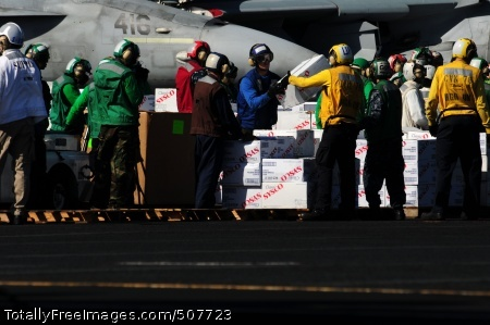 101109-N-5503T-244 PACIFIC OCEAN (Nov. 9, 2010) Sailors assigned to the aircraft carrier USS Ronald Reagan (CVN 76) and embarked Carrier Air Wing 14 unload cases of water off a C-2A Greyhound from Fleet Logistics Combat Support Squadron (VRC) 30. Ronald Reagan was diverted from its current training maneuvers at the direction of Commander U.S. Third Fleet, and at the request of the U.S. Coast Guard, to a position south near the Carnival cruise ship C/V Splendor to facilitate the delivery of 4,500 pounds of supplies to the cruise ship. Early Monday, CV Splendor reported it was dead in the water 150 nautical miles southwest of San Diego. (U.S. Navy photo by Mass Communication Specialist 3rd Class Alexander Tidd/Released)
