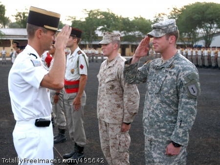 Duty in Djibouti Sgt. Jeremy Verhulst salutes a French officer after graduating from the French Desert Survival Training, organized by the 5th French Marine Regiment, in Djibouti City.  Photo Credit: Dec 28, 2006