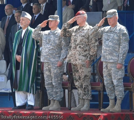 Change of Command Afghan President Hamid Karzai stands alongside, left to right, U.S. Army Gen. Dan K. McNeill, outgoing NATO International Security Assistance Force Commander; German army Gen. Egon Ramms, commander of NATO's Allied Joint Force Command Brunssum; and U.S. Army Gen. David D. McKiernan, incoming ISAF commander, at the ISAF change-of-command ceremony, June 3.  Photo Credit: Jun 3, 2008