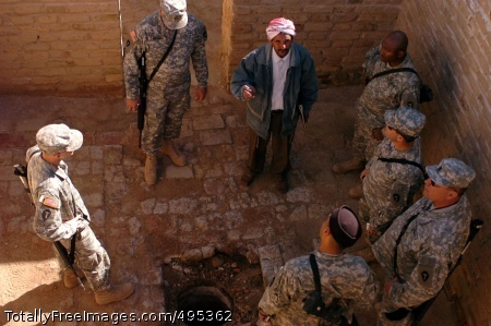 Cradle of Dhief Muhsen shows the Soldiers an original drainage hole, possibly dug by Abraham. Photo Credit: Jan 23, 2007