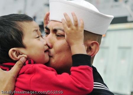 110321-N-BT887-100  SAN DIEGO (March 21, 2011) Hospital Corpsman 2nd Class Neil Palpallatoc embraces his son before deploying aboard the amphibious transport dock ship USS Cleveland (LPD 7) in support of Pacific Partnership 2011. Pacific Partnership is a U.S. Pacific Fleet humanitarian and civic assistance mission designed to strengthen regional partnerships. (U.S. Navy photo by Mass Communication Specialist Seaman Benjamin Crossley/Released)