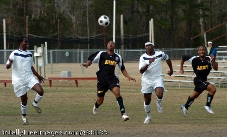 Staff Sgt. Titus Kamau of Walter Reed Army Medical Center in Washington, gets set to head the ball while Staff Sgt. Michael Artis of Fort Bragg, N.C., runs the wing during the All-Army Soccer Team's 1-0 loss to All-Navy in the finale of the men's 2008 Armed Forces Soccer Championship Tournament Feb. 5 at Marine Corps Air Station Cherry Point, N.C. Photo Credit: Feb 11, 2008