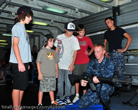 110609-N-BT122-493  PHILIPPINE SEA (June 9, 2011) Gunner's Mate 2nd Class Michael Zimmerman, assigned to the submarine tender USS Frank Cable (AS 40), explains firearm function and safety to guests embarked for a Friends and Family Day Cruise. Frank Cable conducts maintenance and support of submarines and surface vessels deployed in the U.S. 7th Fleet area of responsibility. (U.S. Navy photo by Mass Communication Specialist 1st Class Melvin Nobeza/Released)