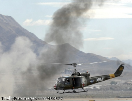 Army Aviation: A A Vietnam-era UH-1 Huey helicopter prepares to land to pick up a role-playing downed pilot. Photo Credit: Nov 15, 2007