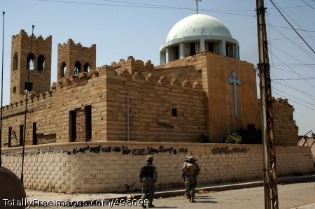 Iraqi Special Soldiers from 101st Airborne Division and 4th Infantry Division assess the damage at the Saint George Church, which was damaged during a past conflict, in Al Doura, Iraq. Photo Credit: Nov 15, 2006