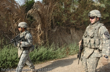 Operating from a nearby combat outpost, Utopia, Texas native Sgt. Ken Thomas (right), a team leader with Troop C, 1st Squadron, 7th Cavalry Regiment, and Sgt. 1st Class Michael Fernandez, Thomas's platoon sergeant, who hails from Killeen, Texas, walk down a road during a foot patrol near Taji, Iraq Oct. 6.  Thomas received the Silver Star during a ceremony at Camp Liberty Aug. 11 for actions taken during an enemy ambush.  Photo Credit: Oct 15, 2007