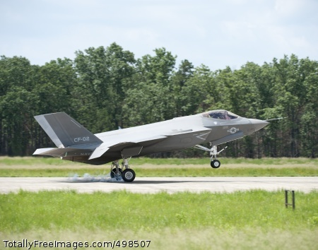 110625-N-ZZ999-001 LAKEHURST, N.J. (June 25, 2011) Test pilot Lt. Cmdr. Eric 'Magic' Buus lands the F-35C test aircraft CF-2 at Joint Base McGuire-Dix-Lakehurst. CF-2 and the F-35 integrated test team from Naval Air Station Patuxent River, Md. are at the Naval Air Systems Command facility in Lakehurst for the first jet blast deflector testing in preparation for carrier shipboard testing in 2013. The F-35C is the carrier variant of the three-service Joint Strike Fighter and has larger wing surfaces and reinforced landing gear to perform in the demanding carrier environment. The F-35C and F-35B are undergoing test and evaluation at Naval Air Station Patuxent River before eventual delivery to the fleet. (U.S. Navy photo by Andy Wolfe courtesy of Lockheed Martin/Released)