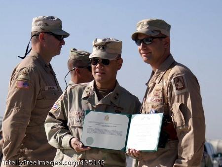Army aviator Army Chief Warrant Officer 3 Christopher Palumbo, 3rd Battalion, 158th Aviation Regiment, is awarded the Silver Star by CJTF-76 commanding general Army Maj. Gen. Jason Kamiya.  Photo Credit: Nov 10, 2005