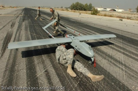 Shadow UAV Sgts. Jeremy R. Squires, Ronald F. Williams and Anh M. Huynh, of the 173rd Airborne Combat Team, attend to a Shadow Unmanned Aerial Vehicle Oct. 18 at Forward Operating Base Fenty on Jalalabad Airfield, Afghanistan.   Photo Credit: Jan 11, 2008