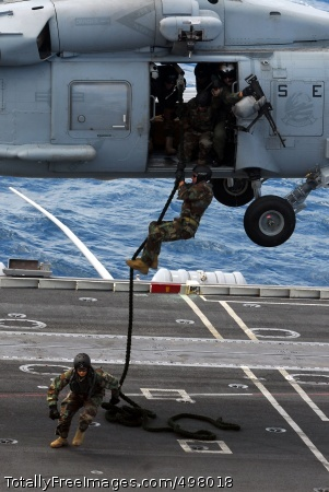 110707-N-WW409-218 INDIAN OCEAN (July 7, 2011) Sailors assigned to Explosive Ordnance Disposal Mobile Unit (EODMU) 5 participate in a fast rope exercise aboard the aircraft carrier USS George Washington (CVN 73). George Washington began its latest patrol on June 12, departing its forward-operating base at Commander, Fleet Activities Yokosuka. (U.S. Navy photo by Mass Communication Specialist 1st Class Jennifer A. Villalovos/Released)