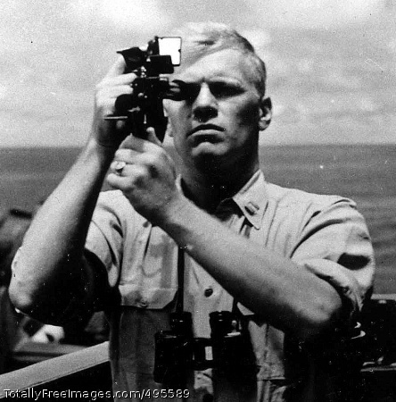 Authors remember U.S. Navy Lt. Gerald R. Ford, navigation officer, takes a sextant reading aboard the USS Monterey in 1944.  Photo Credit: Jan 3, 2007