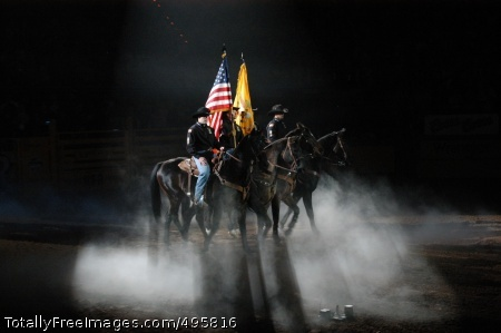 Army team rides From Left: Sgt. Brandon Anderson, Spec. Jesse Silvis, Staff Sgt. Cecil Coplan and Spec. Gerald Johnson, all of the 11th Armored Cavalry Regiment's Horse Detachment, ride out bearing the national colors Dec. 9 during the Professional Rodeo Cowboy's Association Championship at the Wrangler National Finals Rodeo in Las Vegas. Photo Credit: Dec 13, 2006