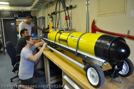 101021-N-5972N-003 SAN DIEGO (Oct. 21, 2010) David Barney (foreground), Eric Sanchez and Daniel Braun, Systems Center Pacific engineers at Space and Naval Warfare Systems Command (SPAWAR), perform pre-deployment inspections on littoral battlespace sensing gliders aboard the Military Sealift Command oceanographic survey ship USNS Pathfinder (T-AGS 60). Each glider hosts a payload suite of sensors that will measure the physical characteristics of the water column as the glider routinely descends and ascends in the ocean. The gliders will be deployed during an at-sea test aboard Pathfinder Oct. 22-Nov. 5. (U.S. Navy photo by Rick Naystatt/Released)