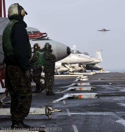 101129-N-7103C-029 WATERS WEST OF THE KOREAN PENINSULA (Nov. 29, 2010) Aviation Boatswain's Mates (Handling) await the arrival of a Super Hornet on the flight deck aboard the aircraft carrier USS George Washington (CVN 73). George Washington is in the waters west of the Korean peninsula preparing for a training exercise with the Republic of Korea Navy. (U.S. Navy photo by Mass Communication Specialist 3rd Class David A. Cox/Released)