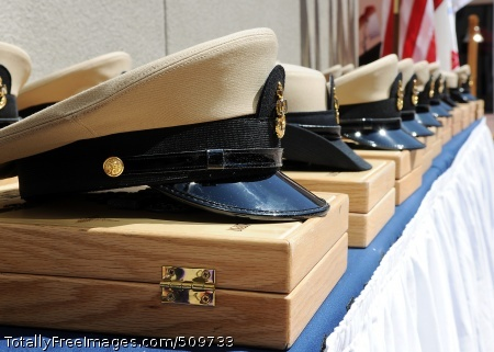 100916-N-6320H-002  SAN DIEGO (Sept. 16, 2010) Chief petty officer combination covers sit on charge books during a chief petty officer pinning ceremony at Naval Medical Center San Diego. (U.S. Navy photo by Mass Communication Specialist 1st Class Todd Hack/Released)