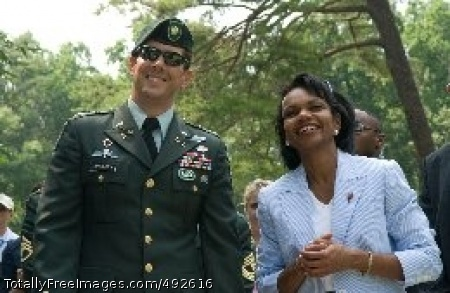 Secretary of State U.S. Army Maj. Jim Gregory, commanding officer of the 3rd Special Forces Group, shares a light moment with Secretary of State Condoleezza Rice at the AT&T National golf tournament, July 6, 2007, in Bethesda, Md. Gregory's detachment recently returned from Afghanistan.  Photo Credit: Jul 6, 2007