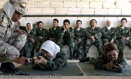 Iraqi Women 'Move Jordanian Warrant Officer Emad instructs trainees from the second class of female Iraqi Army soldiers on proper breathing techniques while firing an AK-47, part of their basic training at the Jordanian Royal Military College in Jordan. Photo Credit: Mar 27, 2007