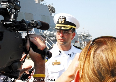 110608-N-YT478-041 NORFOLK (June 8, 2011) Cmdr. Kurt Mondlak, commanding officer of the guided-missile destroyer USS Mahan (DDG 72), is interviewed by local media after the ship returned to Naval Station Norfolk following a seven-month deployment. While on deployment, Mahan conducted maritime security operations and theater security operations in the Horn of Africa and the U.S. 6th Fleet area of responsibility. (U.S. Navy photo by Mass Communication Specialist 1st Class Lolita Lewis/Released)