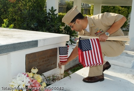 110526-N-QE668-333 KEY WEST, Fla. (May 26, 2011) Senior Chief Air Traffic Controller Pablo Rosado-Vargas, from Quebradillas, Puerto Rico, replaces a flag at the grave of a veteran at the Key West cemetery in honor of Memorial Day. Every year, the Key West Chief Petty Officers Association pays for and places the flags in the cemetery in honor of the service members who have given their lives for our country. (U.S. Navy photo by Trice Denny/Released)