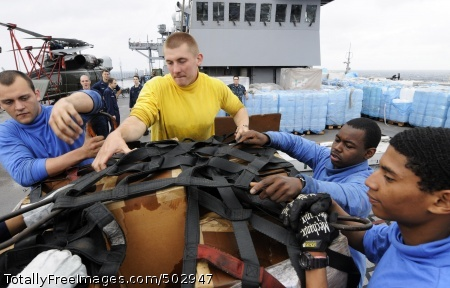 110320-N-5716H-203  EAST CHINA SEA (March 20, 2011) Seaman Kameron Maison, left, Culinary Specialist 3rd Class Drew Iverson, Aviation Ordnanceman Airman Brandon Frasier and Seaman Nicholas Constable stage pallets of relief supplies aboard the U.S. 7th Fleet command ship USS Blue Ridge (LCC 19) for transfer during a replenishment at sea. Blue Ridge is providing disaster relief and humanitarian assistance to Japan as directed in support of Operation Tomodachi. (U.S. Navy photo by Mass Communication Specialist 1st Class Josh Huebner/Released)