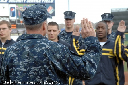 p>COLORADO SPRINGS, Colo. - Navy Adm. James Winnefeld, North American Aerospace Defense Command and U.S. Northern Command commander, gives the oath of enlistment to 12 U.S. Navy enlistees at the Sky Sox - Grizzlies game at Security Services Field May 3. The Admiral was also invited to throw out the first pitch.