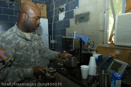 Chief Warrant Officer Tilden Morgan, an electronic missile systems technician with the 15th Brigade Support Battalion, 2nd Brigade Combat Team, 1st Cavalry Division, prepares a shot of espresso at his office at Forward Operating Base Prosperity in central Baghdad. Morgan and his wife own Java Jolt, a coffee shop located in Killeen, Texas.  Photo Credit: Oct 24, 2007