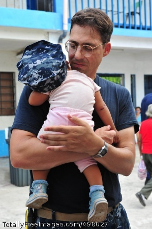 110706-F-NJ219-171 PUERTO SAN JOSE, Guatemala (July 6, 2011) Lt. Cmdr. Jason Layton, a nurse from Wexford, Penn., holds a baby during a Continuing Promise 2011 medical community service project at the Santa Isabel medical site. Continuing Promise is a five-month humanitarian assistance mission to the Caribbean, Central and South America. (U.S. Air Force photo by Staff Sgt. Courtney Richardson/Released)